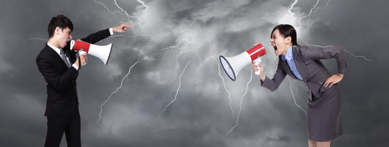 20726496 - business man and woman shouting to each other through megaphone on danger precipice on the mountain with rainstorm clouds and lightning